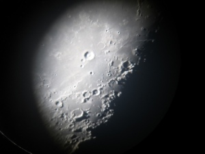 """Photo of the Moon taken on a camera and placed on the eyepiece of the 60"""" telescope. Photo by Janet Greene."""